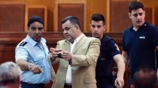 L'ancien député d'Aube dorée Yiorgos Roupakias, assassin présumé du rappeur antifasciste Pavlos Fyssas, le 7 mai 2015 au tribunal.