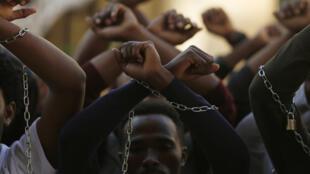 Ethiopian migrants, all members of the Oromo community of Ethiopia living in Malta, protest against the Ethiopian regime in Vall