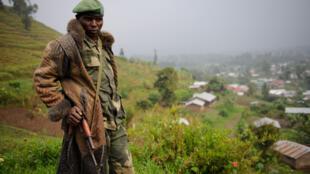 Un rebelle du M23 sur les hauteurs de Bunagana, en juillet 2012.