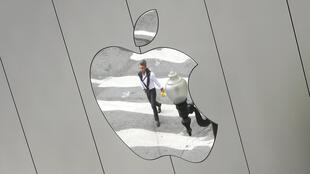 A man is reflected in a Apple store logo in San Francisco, California, U.S., August 21, 2017.