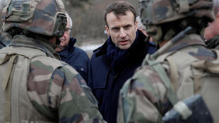 French President Emmanuel Macron meets with officers as he attends a military exercise at the military camp of Suippes, near Reims, France, March 1, 2018.