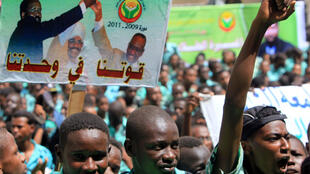 Students rally calling for support for unity between south and north Sudan at the National Assembly in Khartoum