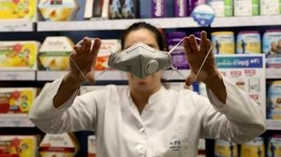 A pharmacist holds a protection class FFP2 respirator mask, amid the novel coronavirus outbreak, in Barcelona, Spain February 4, 2020.