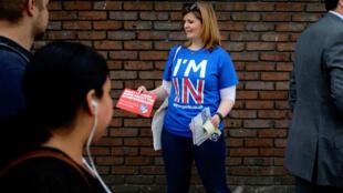 A Remain campigners leaflets before Thursday's referendum