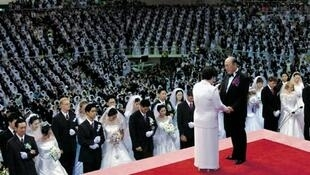 The Unification Church's Rev Sun Myung Moon peforms a mass blessing in 2010