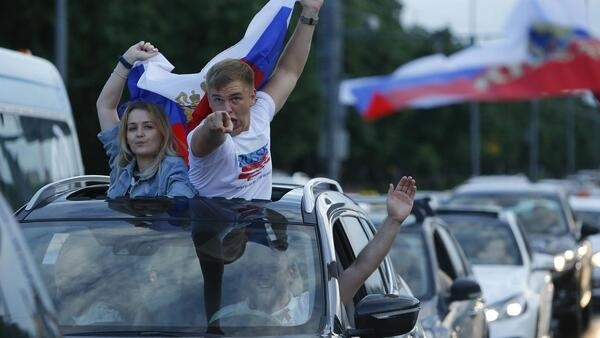 Russian supporters celebrate the victory against Spain