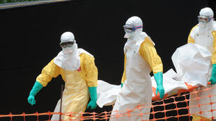 A Doctors Without Borders volunteers trasnport the body of an Ebola victim in Guinea this week