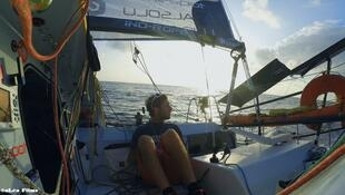 Ian Lipinski winner of the 2015 and 2017 Transat 650 solo races sits in his boat in the mid Atlantic. He's the focal character in Léa Rinaldi's documentary, 'Wakes', 2019
