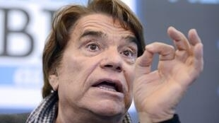 "French businessman Bernard Tapie gestures while delivering a speech during a press conference on March 12, 2014 in Marseille, southern France, to announce the launch of a web TV, a new branch of the French newspaper ""La Provence""."