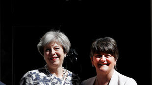 Britain's Prime Minister, Theresa May with Democratic Unionist Party (DUP) Leader Arlene Foster, in front of 10 Downing Street in London on 26 June, 2017.