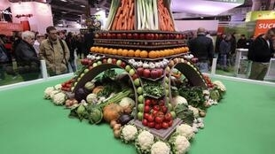 An Eiffel tower model built with fruits and vegetables at the 52nd agricultural fair in Paris