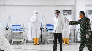 2020-03-23T000000Z_247843744_RC2HPF94QGMR_RTRMADP_3_HEALTH-CORONAVIRUS-INDONESIA