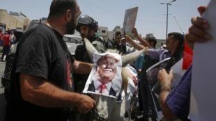 Protesto dos palestinianos contra fórum económico sobre a Palestina. 25 de Junho de 2019.