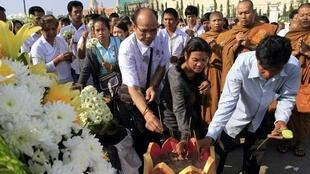 Cambodians burn incense sticks as they pay their respects to the stampede victims in Phnom Penh.