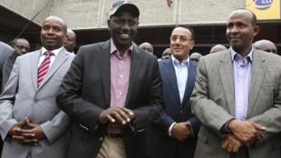 Kenya's Deputy President William Ruto (C) leaves the Jomo Kenyatta airport in Nairobi, as he makes his way to the International Criminal Court