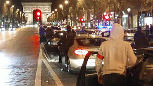 Around 500 police officers in plain clothes take part in a protest on the Champs-Elysees avenue overnight on October 18, 2016 in Paris, after four officers were injured when a group of youths swarmed their cars on October 8 in Viry-Chatillon and lobbed Mol