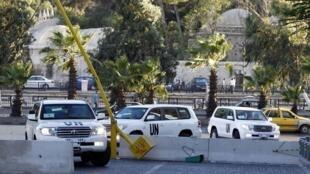 Los vehículos que transportan a los expertos, este 3 de octubre en Damasco.