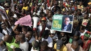 Pro-Biafra supporters hold a poster of jailed activist Nnamdi Kanu during a protest in Aba, southeastern Nigeria, calling for his release.