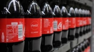 Bottles of Coca-Cola are pictured at a branch of Asda in north London, on April 27, 2018.