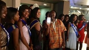 Franck Yaboue flanked by the Miss Cote d'Ivoire contestants at Afric Art Launch in Abjidjan, Côte d'Ivoire