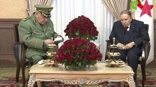 Canal Algérie, AFP | A video grab taken from footage broadcast on March 11, 2019 shows Algerian President Abdelaziz Bouteflika (right) meeting with army chief Ahmed Gaid Salah in Algiers.