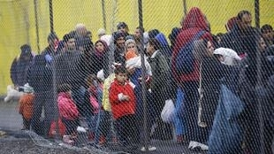 People trying to cross Europe wait at the Spielfeld checkpoint on the border of Austria and Slovenia.