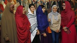 Nobel Peace Prize laureate Malala Yousafzai (3rd R) greets young women activists whom she invited to the Nobel award ceremony