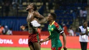 Michael Ngadeu-Ngadjui, who scored Cameroon's first goal celebrates his side's semi-final victory over Ghana with skipper Benjamin Moukandjo.