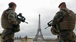 Soldiers on patrol at Paris's Eiffel Tower last year