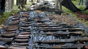 Captured militant weapons is displaced in front of bodies of killed al-Shabaab fighters in Mpekatoni