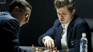Magnus Carlsen (right) scored a win in the eight round of the Norway Chess tournament on Wednesday