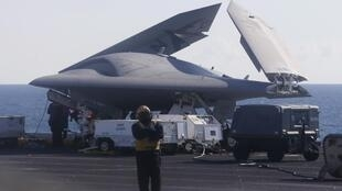 An X-47B pilot-less drone combat aircraft with its wings folded before being launched