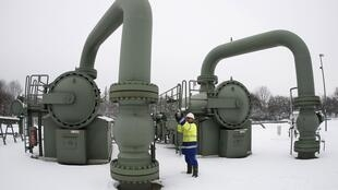 A technician inspecting a compressor station, which helps the transportation of natural gas, in Huenxe, Czech Republic.