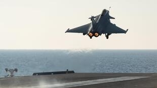 A Rafale aircraft takes off from the nuclear-powered aircraft carrier Charles de Gaulle during operations in the Mediterranean Sea, 23 November 2015.