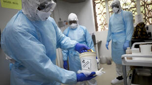 Mali, mired in an eight-year-old conflict, said two nationals who had returned from France tested positive for the virus. Here, a Malian researcher holds a sample to be tested at a research center in Bamako