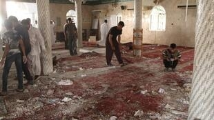 Surveying the damage after a deadly suicide bombing at a Shiite mosque in Qatif, Saudi Arabia, 22 May 2015.