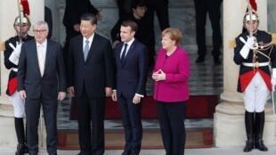 从左至右:容克、习近平、马克龙、默克尔,中欧德法峰会时在法国爱丽舍宫          2019年3月26日