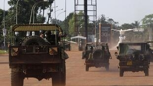 French soldiers patrol on military trucks on the streets in Bangui , 10 ecember, 2013