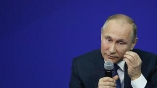 Russian President Vladimir Putin speaks during a meeting ahead of the upcoming presidential election in Moscow