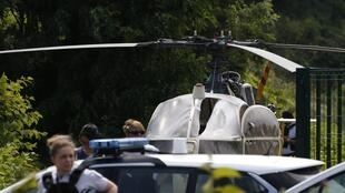 Police search the hijacked helicopter abandoned by Redoine Faïd and his accomplices north of Paris after his jailbreak on 1 July 2018.