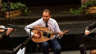 Michael Onsy plays the oud during a concert