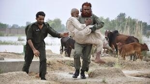 An army personnel evacuating residents in Pakistan's Punjab province
