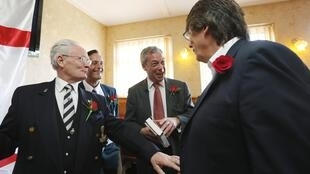 United Kingdom Independence Party (UKIP) leader Nigel Farage talks to veterans at the Northwood Club in Ramsgate, southern England.