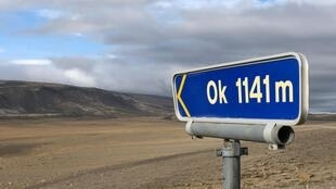 A signpost shows the way to the former Okjokull glacier, in western Iceland.