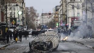 A car burns outside the Lycee Professionnel Jean-Pierre Timbaud high school after being set ablaze by students protesting against French government Education reforms on December 3, 2018 in the north of Paris' suburb of Aubervilliers.