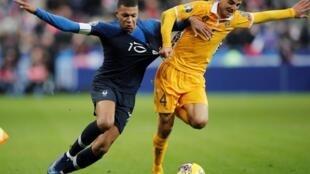 Stade de France, Saint-Denis, France - November 14, 2019 Moldova's Sergiu Platica in action with France's Kylian Mbappe