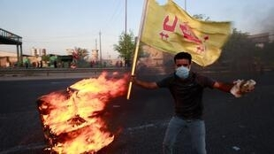 Anti-government protestors on the streets of Baghdad.