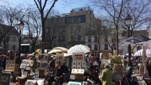 Họa sĩ trên Quảng trường Tertre, Montmartre, Paris.