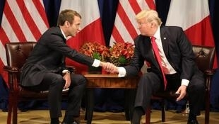 France's president Emmanuel Macron (L) and US President Donald Trump shake hands before a meeting at the Palace Hotel during the 72nd session of the United Nations General Assembly on September 18, 2017, in New York.