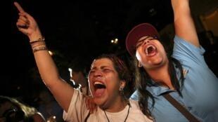 Des cris de joie des partisans de la coalition de l'opposition, la MUD, à Caracas, le 7 décembre 2015.